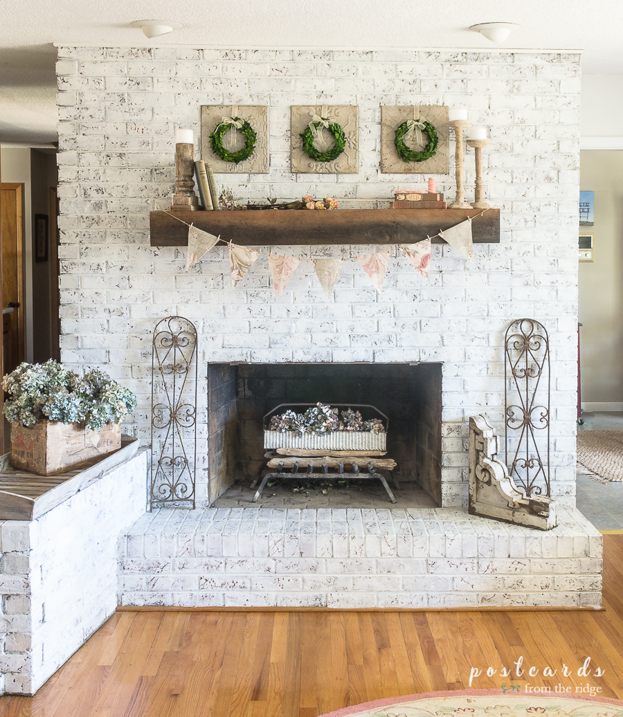 white brick fireplace with spring decor