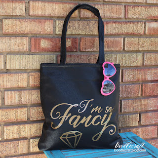 http://www.doodlecraftblog.com/2016/04/im-so-fancy-vinyl-on-faux-leather-tote.html
