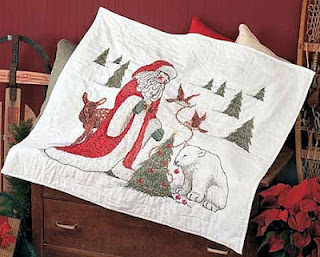http://www.christmascraftcollection.com/2012/07/santa-friends-lap-quilt-top.html