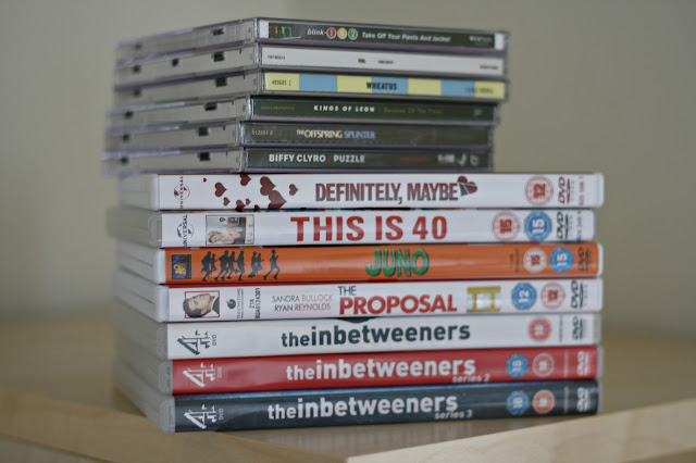 dvd and cd piles
