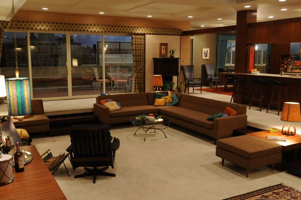 The color scheme in this living room area and sectional are 60s decor inspired.