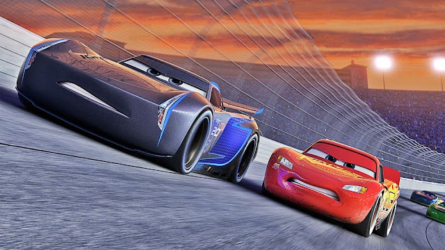"A scene from ""Cars 3"", in which cars drive like cars."