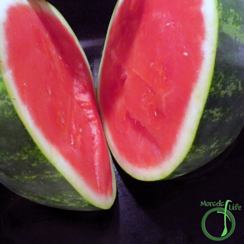 Morsels of Life - How to Cut a Watermelon Step 2 - Cut watermelon in half.