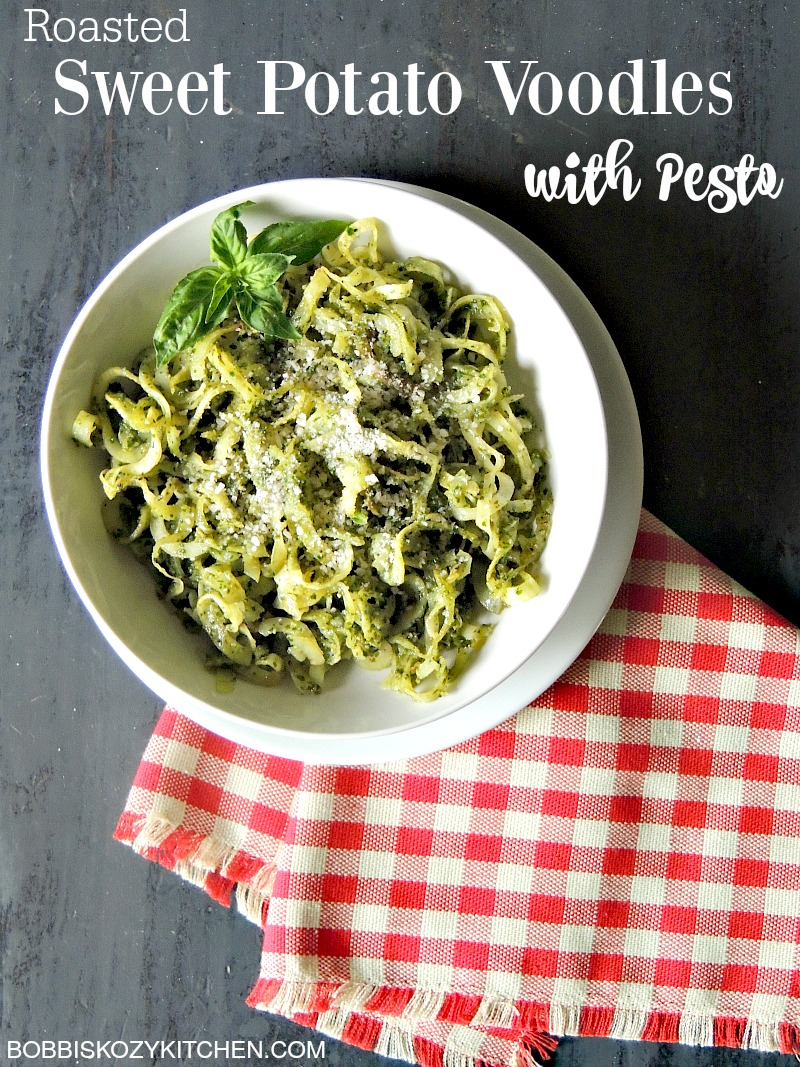 Roasted Sweet Potato Noodles with Pesto - Spiralized sweet potato noodles bathed in delicious homemade pesto, makes a fabulous side dish for any meal. From www.bobbiskozykitchen.com