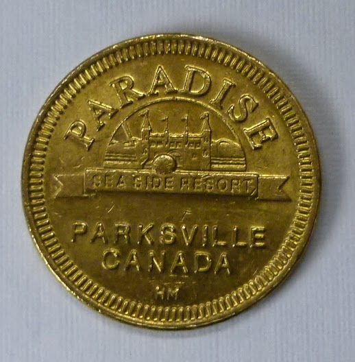 A token from the games arcade at Paradise Fun Park, Parksville, Canada