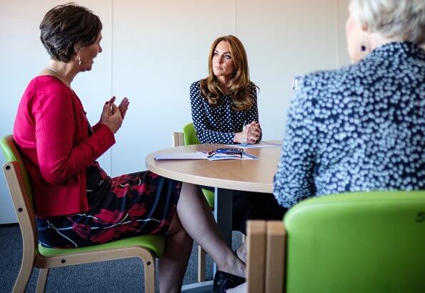 Kate Middleton wore a new polka-dot shirt by Equipment.and she wore a new high-waist wide leg trousers by Zara
