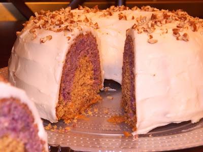 Cranberry Orange Tunnel Bundt Cake, purple and orange bundt cake, white frosting with nuts