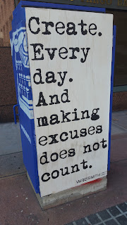 "A sign reads ""create everyday, and excuses does not count"""