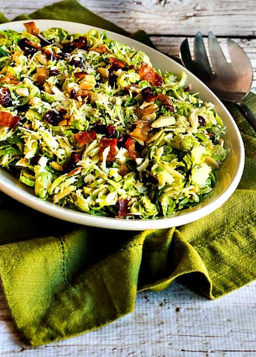 Brussels Sprouts Salad with Bacon, Dried Cranberries, Almonds, and Parmesan [found on KalynsKitchen.com]