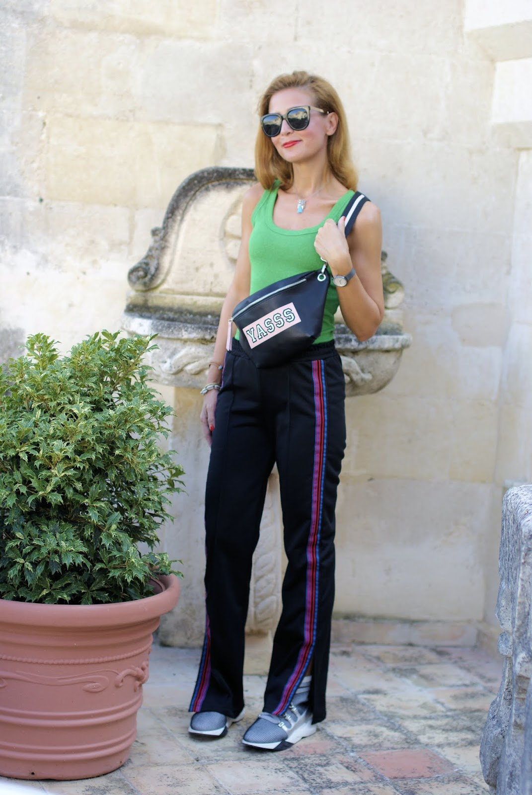 Athleisure style outfit with tank top and belt pouch on Fashion and Cookies fashion blog, fashion blogger style