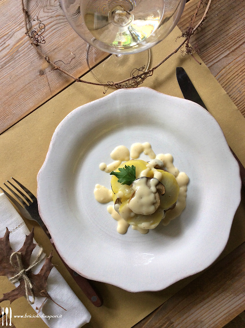 tortino di patate e funghi con fonduta di parmigiano