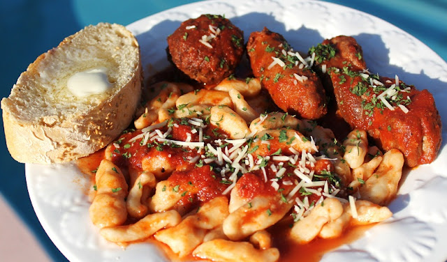 this is a homemade cavatelli pasta with thick tomato Italian sauce with sausage and meatballs with pork spare ribs