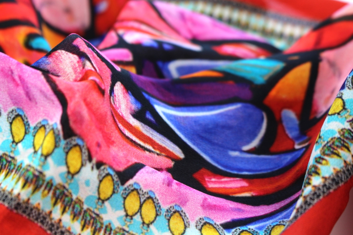 This is a close-up of one of the props for this shoot, which is a really colorful Shahida Parides scarf with a heart design.