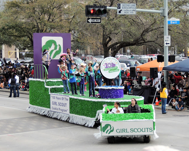 GIRL SCOUTS FLOAT AT THE RODEO PARADE