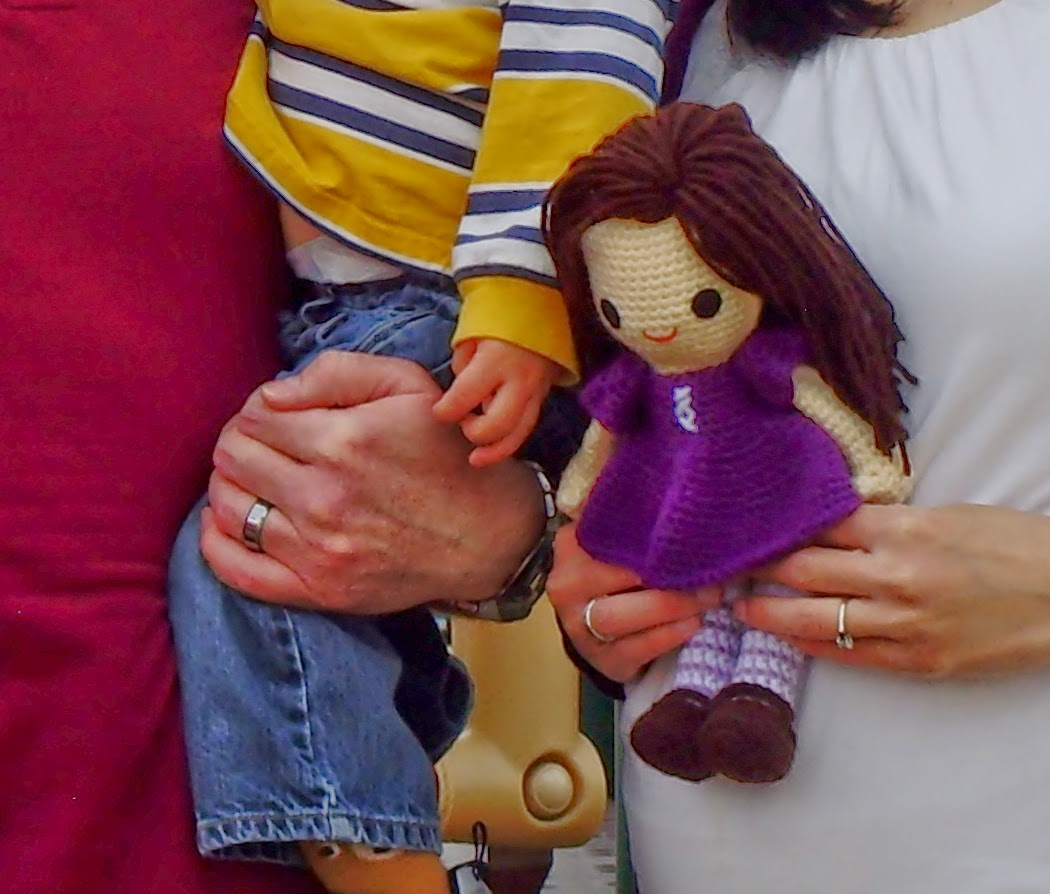 Baby girl gender reveal family portrait with crochet amigurumi doll