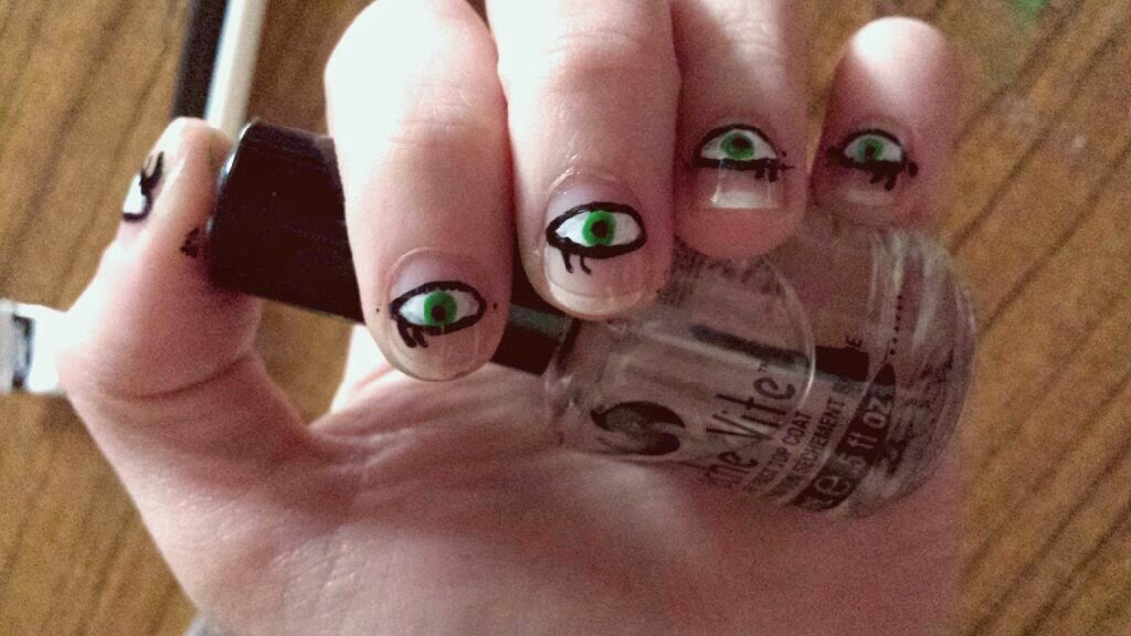 Negative space nail art eyes