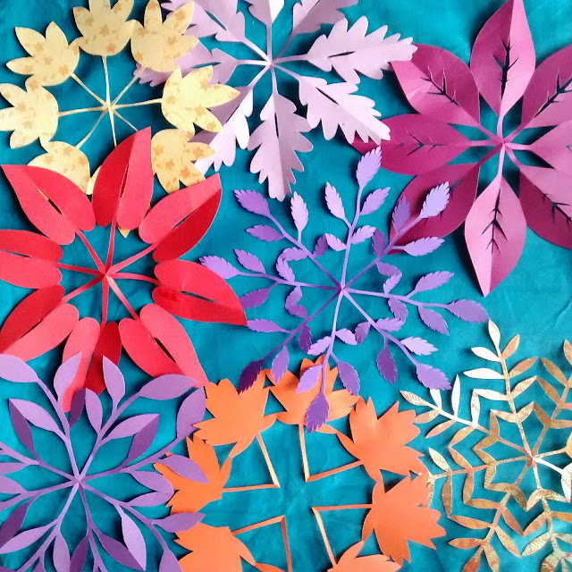 Lots of leafy paper snowflakes