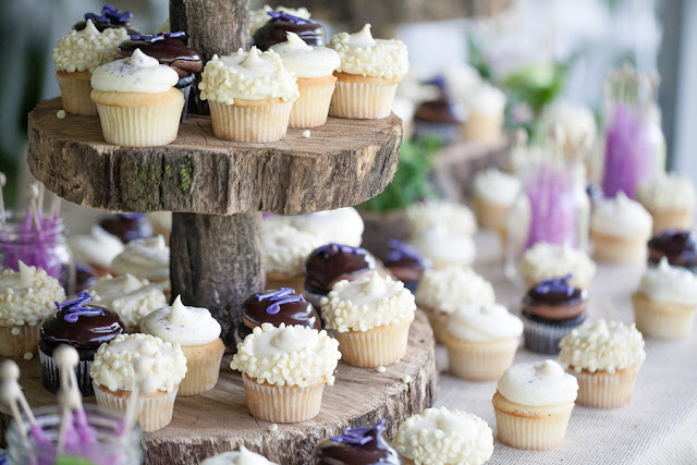 rustic+wedding+shabby+chic+summer+spring+burlap+moss+green+purple+violet+lavender+mint+emerald+outdoor+horse+cowboy+centerpiece+cake+table+dessert+candy+buffet+1326+studios+24 - Rustic Springtime