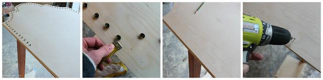 Adding nailhead trim to a headboard.