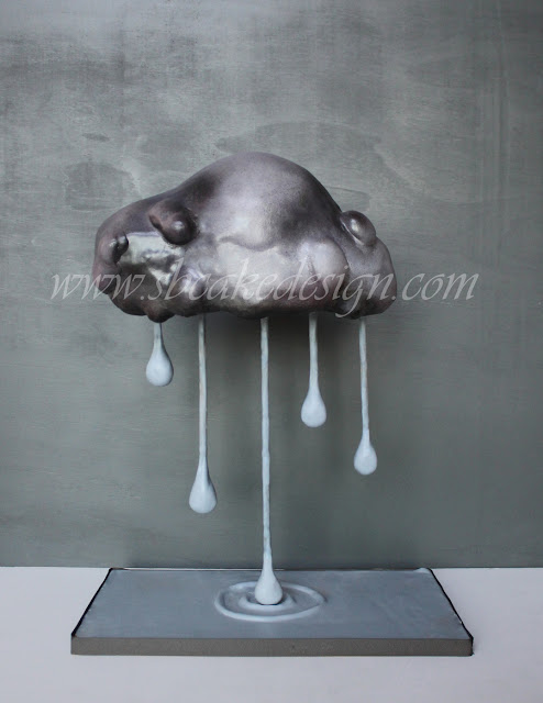 http://www.cakecentral.com/gallery/i/3306865/rain-cloud-cake