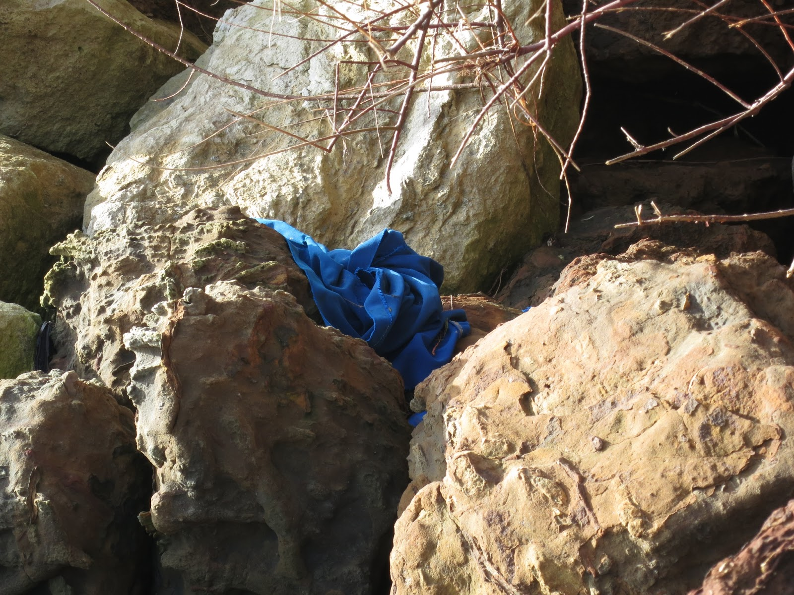 Blue cloth on rocks.