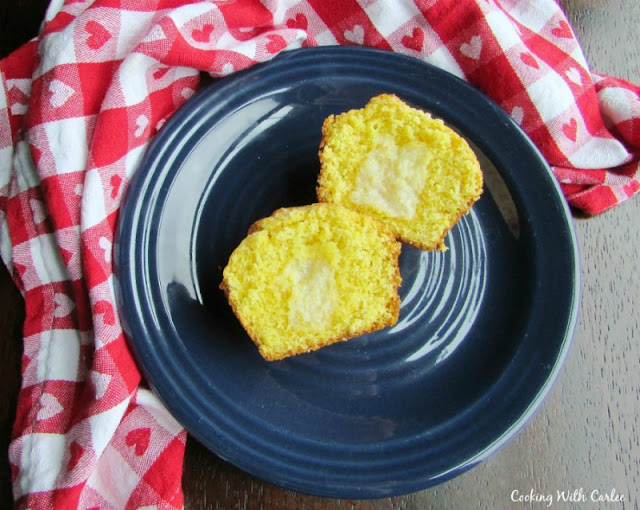 corn muffin split in half and spread with melted butter