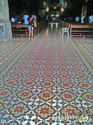 Colorful flower inspires floor tiles used in Nagcarlan Church floors and isle