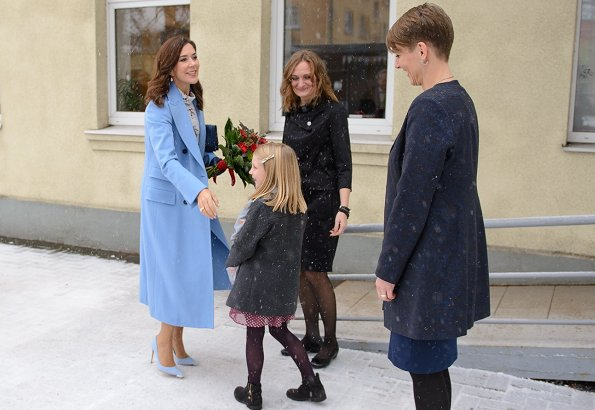 Crown Princess Mary wore Stine Goya blouse, Ralph Lauren wool coat, Gianvito Rossi Pumps and carried Quidam clutch