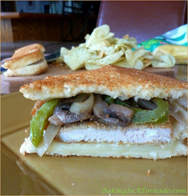 Breaded Turkey Cutlet Grilled Cheese, a smoky grilled cheese sandwich made with a breaded pan fried turkey cutlet and accented with sauteed vegetables | Recipe developed by www.BakingInATornado.com | #recipe #turkey #sandwich