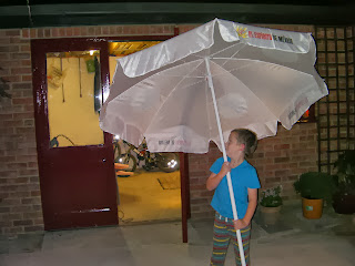 boy holding giant umbrella