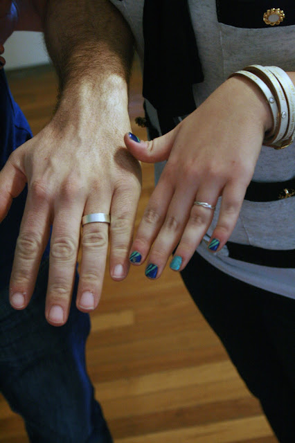 Kristen and Kevin showing off their wedding bands after spending the day making them for each other.