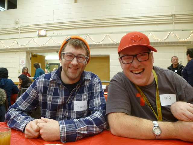 Happy tutor-learner pair enjoying themselves at the holiday party.