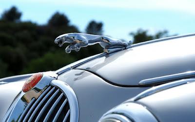 Classic jaguar car with iconic cat logo