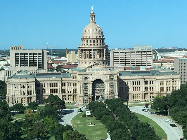 Not a bad view from my office window. The Texas capitol, with Longhorn Stadium in the background.