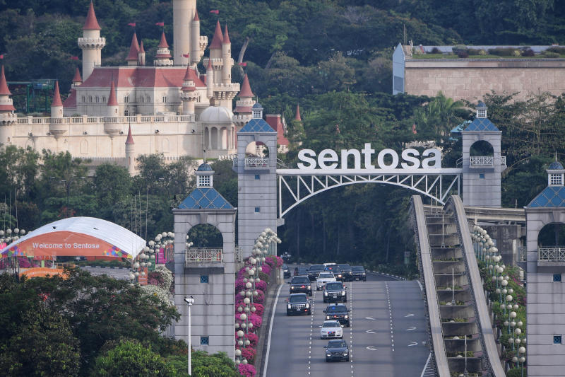US President Donald Trump's motorcade travels out of Sentosa after his summit with North Korean leader Kim Jong Un as photographed from Propeller Rooftop Bar at Bay Hotel Singapore.