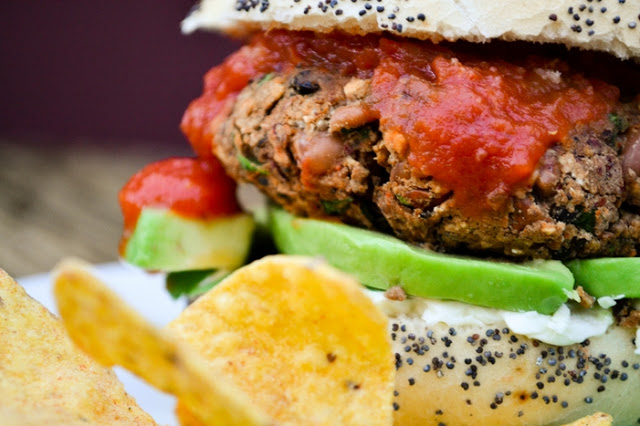 An easy but utterly delicious bean burger in a bun with salad, avocado and relish