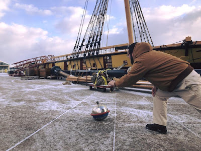 Niagara_captain_throws_curling_stone_on_museum_plaza