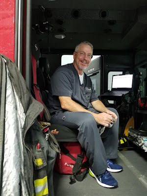 Dr. Kitzmiller sitting in a fire truck.