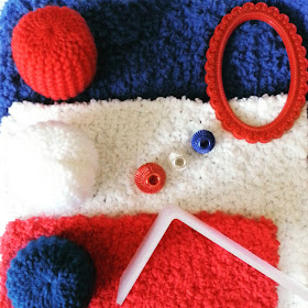 One-twelfth scale modern miniature fluffy rugs, knitted pouffes and accessories in the colours red, white and blue.