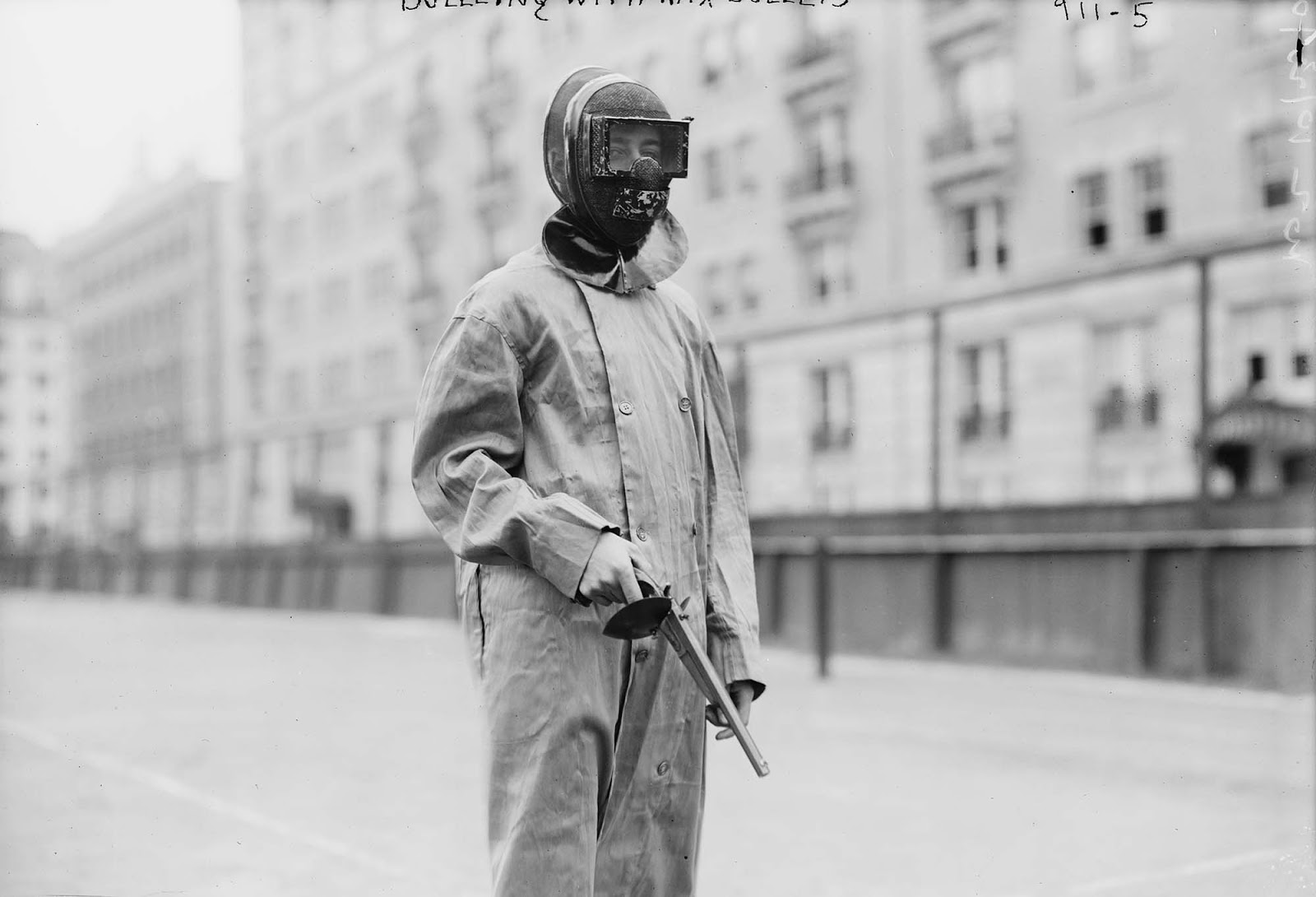 Note the handguard on the pistol's grip to shroud the shooter's exposed hand. The wax bullets used in 1909 were just less-than lethal.