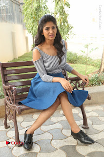 Telugu Actress Roshini Prakash Stills Short Dress at Saptagiri Express Release Press Meet  0184.JPG