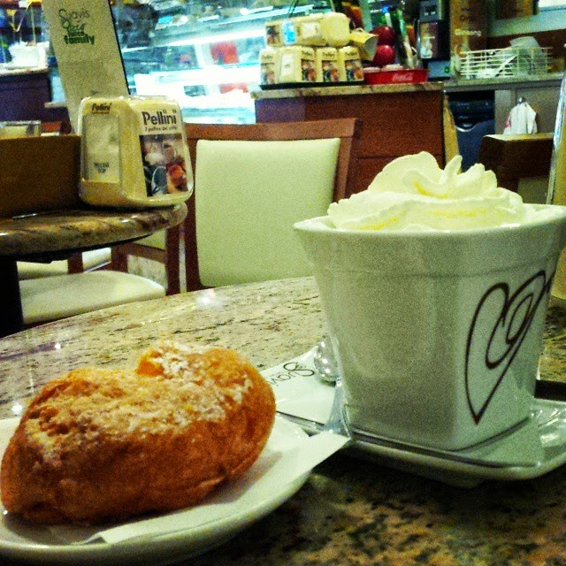 Hot chocolate with a fritella in a Vicenza cafe