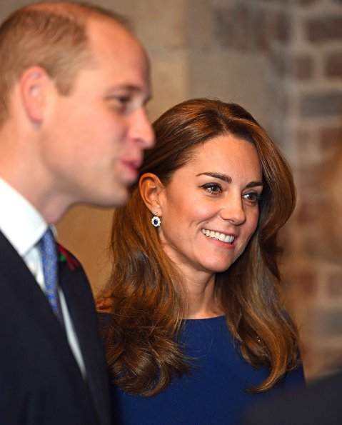 Kate Middleton wore Emilia Wickstead Kate a-line wool crepe dress in navy blue. Poppy Collection the first world war diamond brooch