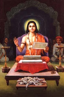 Jneshwar sits at his writing desk