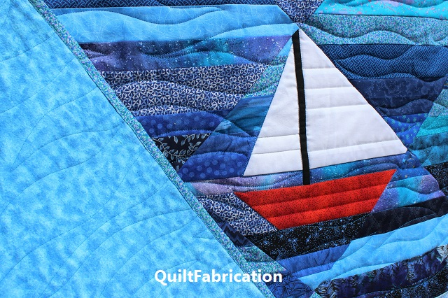 sailboat and flannel backing on the Seafarer quilt