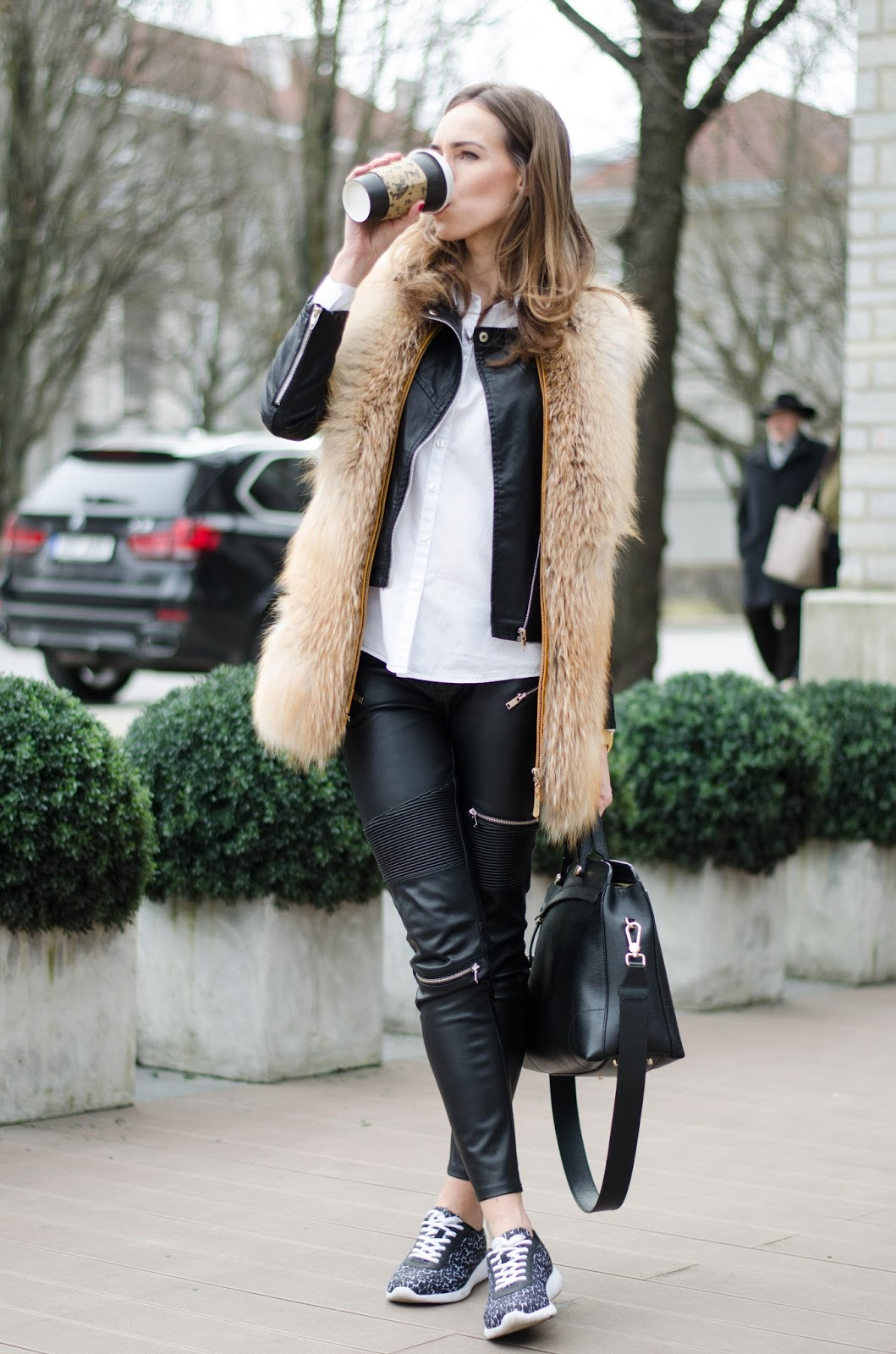 kristjaana mere fur vest leather pants sneakers outfit