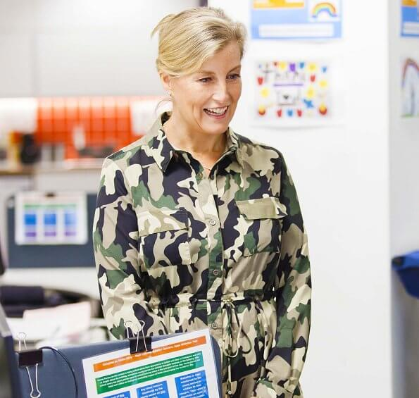 Sophie, Countess of Wessex wore French Connection Camo midi shirt dress in khaki. Countess of Wessex wore a white wool dress, gold earrings
