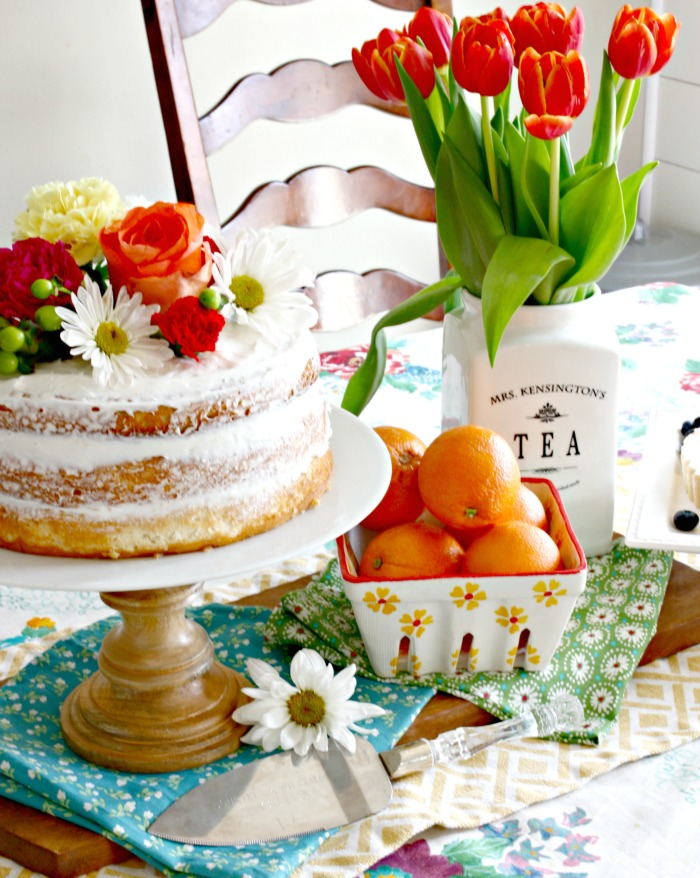 Easy Spring Naked Cake Made Using Boxed Cake Mix & Grocery Store Flowers - www.goldenboysandme.com