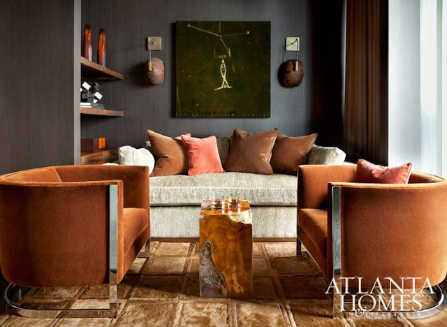 Gorgeous pumpkin velvet chairs in chic room via Atlanta Homes