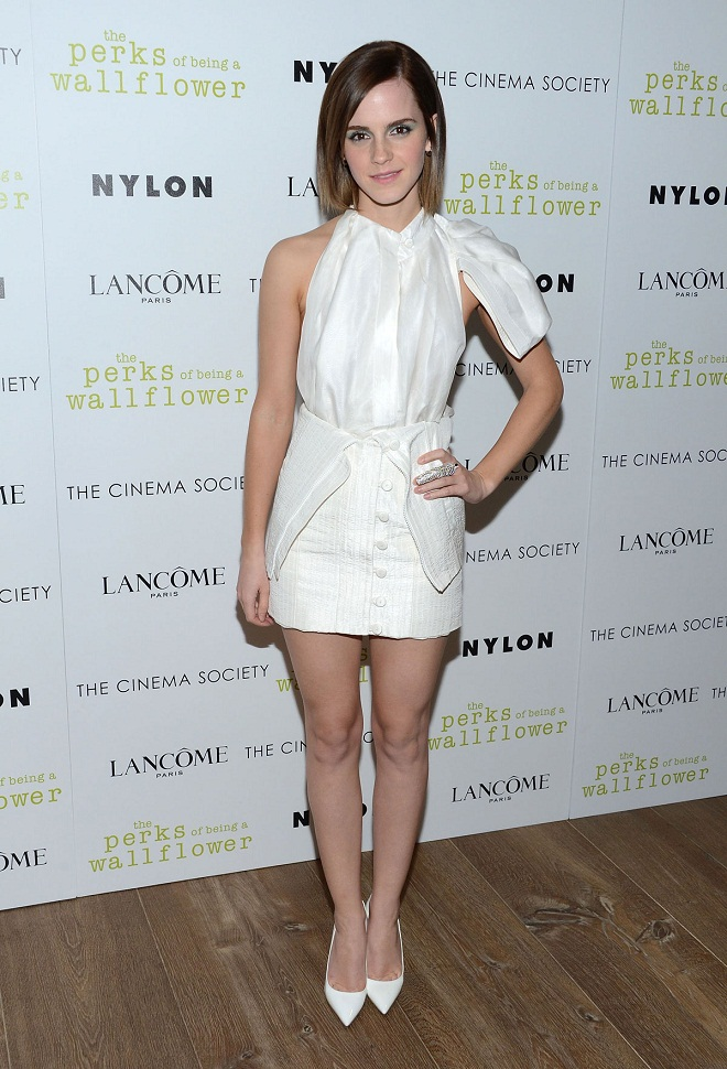 emma watson shows off skin in a white dress at the perks